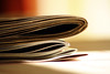 Newspaper and Magazines (lowbattery) Tags: news colour magazine paper warmth folded platinumheartaward