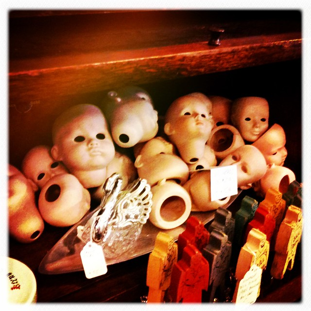 A pile of doll heads