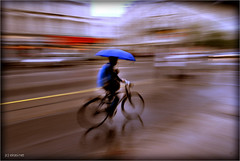cycling with an umbrella - by eir@si