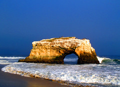 After the storm (Speck in Time) Tags: california blue sea usa santacruz seascape storm beach birds stone gold arch naturalbridges supershot worldbest anawesomeshot superaplus aplusphoto naturewatcher