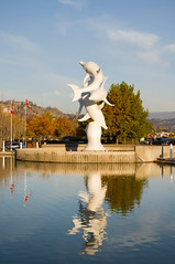 IMGP7449 (Jason Drury) Tags: vacation sculpture canada reflection fall tourism colors leaves britishcolumbia okanagan dolphins kelowna