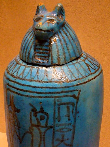 This would be a jar that the inner organs would be kept in after mummification. (Notice it has the head of Anubis god of embalmment as the lid)
