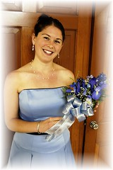 Sister of the Bride (d_wooden) Tags: portrait bridesmaid lillies d100 simplybeautiful beautifulbrunette sleevelessdress smiletomeltyourheart