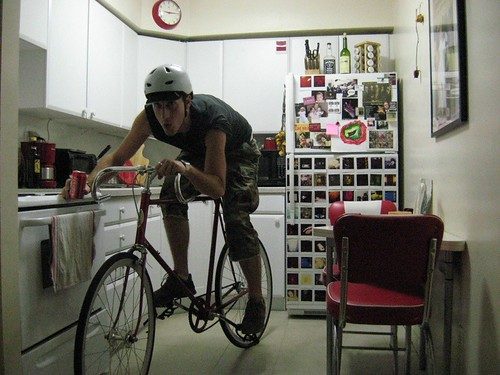 new bike (with tecate) (in kitchen)