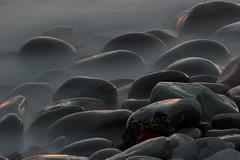 Rocks (John Spooner) Tags: sea twilight dusk stones shore creativecommons seashore dumfriesgalloway galloway dumfriesandgalloway machars monreith cotcmostfavorited i500 wigtownshire southwestscotland johnspooner diamondclassphotographer dumgal