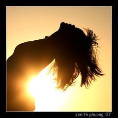 sunset (Zenith Phuong) Tags: light sunset shadow woman sun selfportrait beach portugal girl face silhouette set lady female mouth dark hair faro eyes feminine south zenithphuong selectedasthebest abigfave impressedbeauty