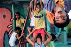 Upside down - Kolkata India (Maciej Dakowicz) Tags: poverty travel boy india home girl canon fun hope asia play action indian orphanage 5d shelter kolkata calcutta westbengal
