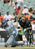 India s Dinesh Karthik plays a shot as N