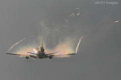 Vapor! (Nick - Skeyes aerial photography) Tags: west 20d airplane nw north bank airline condensation takeoff vapor nwa dc10 ef100400mm