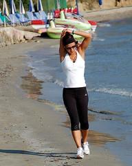 Stretch! (RobW_) Tags: morning beach early used greece monday stretching jogger elsewhere zakynthos tsilivi july2007 jul2007 02jul2007