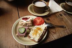 (sandra juto) Tags: wood shadow cup metal cheese tomato table tea napkin cucumber plate spoon scones brie sandwiches saucer fika orangemarmelade liverpt figmarmelade