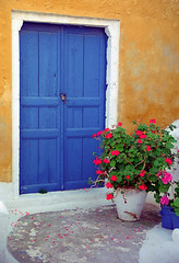 Oia Doors, No. 3 (h_roach) Tags: vacation vertical outdoors petals europe doors nopeople santorini greece pottedplant geraniums greekislands picturesque oia bluedoor thera buildingexterior traveldestination flickrsbest onlyyourbestshots diamondclassphotographer flickrdiamond intelligenttravel