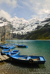Blue Boats (Fabio Montalto) Tags: lake snow alps landscape boats switzerland kandersteg oeschinensee nikond200 colorefexpro nikfilters platinumheartaward nikon1685 capturenx2 wagman30