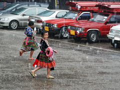 Hmong girl in the rain (grantthai) Tags: girl geotagged thailand costume thai chiangmai ethnic doisuthep hmong hilltribe blueribbonwinner geo:lat=18815663 geo:lon=98882897