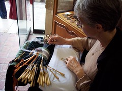 A lacemaker at work.