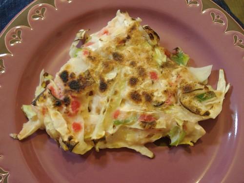 Okonomiyaki is a typic...