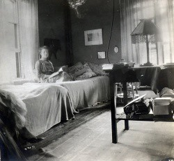 A student in her newly electrified room in Main Building, circa 1912.