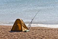 Fishing off Chesil Beach. (doublejeopardy) Tags: sea beach fishing dorset rod chesilbeach kartpostal