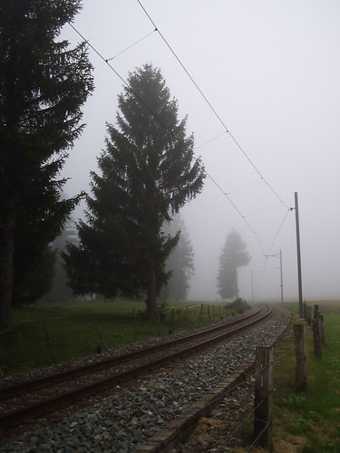 Jura train tracks in the mist in Switzerland Suisse