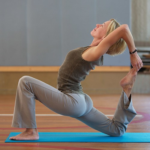 Anne Hungerford performs one-legged king pigeon yoga posture