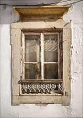 still beautiful after all these years (julioc.) Tags: old houses windows urban white house portugal window beautiful stone wall architecture faro ventana geometry decay quality traditional nopeople olympus symmetry textures janela algarve typical oldcity decayed faade urbex precarious e510 julioc challengeyouwinner photographybyjulioctheblog olympuse510 ossonoba ilustrarportugal janelasportuguesas j1024