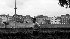 running man (glasseyes view) Tags: bw afternoon sunday sw maas runner oldtown mmastricht glasseyesview