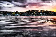 [ripples across the sunrise] (kylepost photography) Tags: morning reflection water beautiful yellow clouds sunrise dawn coast colorful purple wave calm fallretreat distance serence banksonlake miraclecamp