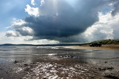 Storm clouds across the estuary (CharlesFred) Tags: ireland sea cloud sun coast eire atlantic coastal splash wexford atlanticocean emeraldisle oceam countywexford oirland irishcoast