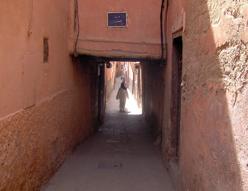 Woman walking down alley, Marrakesh