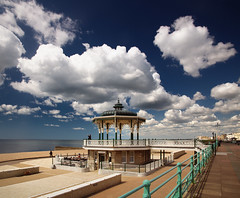 the brighton bandstand under amazing clouds (Laurence Cartwright) Tags: uk sea england beach clouds sussex photo cafe brighton victorian photograph esplanade promenade blueskies seafront bandstand railings kingsway polariser brightonandhove peacestatue vertorama laurencecartwright summertimeuk