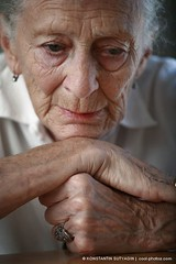 Portrait of a senior woman thinking with head on nands. (Konstantin Sutyagin) Tags: life old portrait people woman white color senior beautiful face look vertical closeup lady table person sadness one photo hands pretty solitude mood sitting moody loneliness gloomy sad looking head think gray thoughtful lifestyle headshot indoors thoughts elderly age single thinking wise wisdom sorrow citizen issues generation grief retirement pondering contemplation caucasian selectivefocus shallowdof retire wize greyhaired grayhaired wizdom strobist