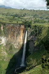 Sipiso piso waterfall, Sumatra - Indonesia (Marjan de B) Tags: travel vacation mountains water sunshine clouds sumatra indonesia landscape island waterfall rocks asia shade 2007 deblaauwpix