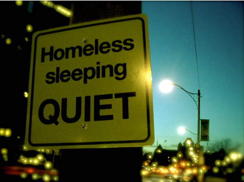 homeless-sleeping-quiet-sign