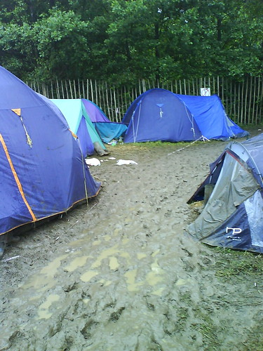 A river of mud slips gently by our tent