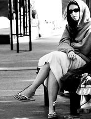 The Impolite Hood (Accretion Point) Tags: blackandwhite girl sunglasses waiting sitting bodylanguage towel smoking hood outstandingshots wowiekazowie