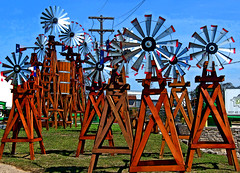The Windmills of your Mind (Texas Finn) Tags: wood blue red sky art water windmill yard rural movie fan wooden oscar energy texas harrison tank power searchthebest thomas song farm spin steve rustic barrel noel blow storage pump round winner theme crown 1968 soe affair lumber faye mcqueen weatherford blueribbonwinner dunaway colorphotoaward goldenphotographer wowiekazowie theperfectphotographer alohagroup