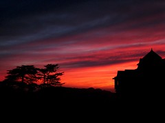 Twilight at Shimla - On Explore (sir_watkyn) Tags: sunset sky orange india mountains crimson yellow clouds canon landscape gold shimla interestingness silhouettes explore hues soe himachal himalayas pradesh on supershot abigfave platinumphoto aplusphoto ysplix theunforgettablepictures goldstaraward flickrlovers micarttttworldphotographyawards micartttt sirwatkyn