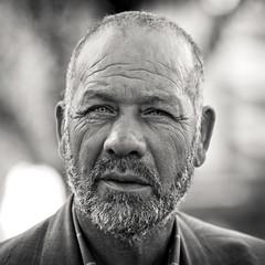 Beautiful Stranger (Fabrice Drevon) Tags: blue portrait bw beard french nice eyes nikon riviera lj 85mm f18 gaze d90 fabricedrevon