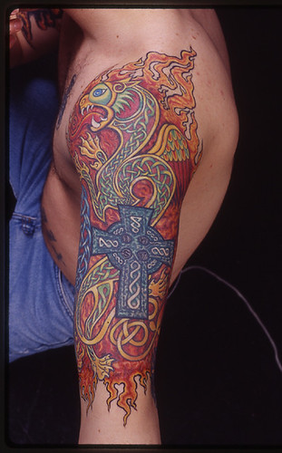 Celtic Knotwork with Cross and Lion by Denizen (Denise de la Cerda). Tattoo