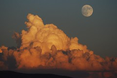 Moonrise over sunset clouds