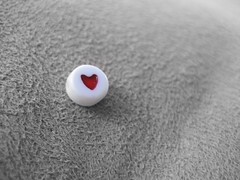 Love lives in little places (jmumma) Tags: red bw love bead selectivecolour loveheart redbead