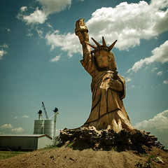 Statue of Libertree (Wade Griffith) Tags: wood sky mill clouds rural america square texas country grain carving silos statueofliberty panhandle nazareth wadegriffith2010