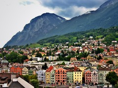 Idyllic Innsbruck (bekahpaige) Tags: city travel houses mountain alps tower austria colorful europe village view tourist alpine oldtown tyrol innsbruck supershot stadtturm citytower 25faves abigfave anawesomeshot colorphotoaward impressedbeauty aplusphoto ultimateshot superbmasterpiece travelerphotos superhearts flickrelite