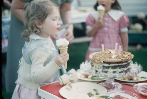 Jan eats an ice cream cone at her 3rd birthday party