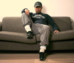 Russell (Stewart Leiwakabessy) Tags: socks glasses athletic russell flash nike couch stewart om levis whitewall nikes asianman leiwakabessy stewartleiwakabessy grayhat bluetshirt singlephoto brownfloor stewartleiwakabessy sittingongraysofa graytrousers