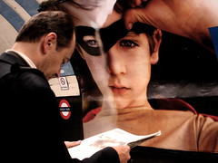 boy wonder (chutney bannister) Tags: man london look station poster reading newspaper kid waiting child candid ad tube platform billboard advertisement advert greenpark stare londonunderground bb westbound piccadillyline eyemask xyz engrossed fp2 londonist sline surrl