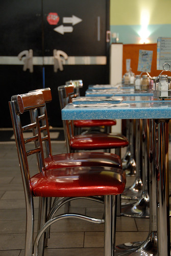 Photo by:  Smaku:  After all-nighters its usually a good thing to replenish your body with some good old fashioned greasy grub.  Frans diner is open 24 hours and has some great grub. After sitting down at our table, these set of tables here quickly filled up with about 8 police officers all off-duty coming to get their morning breakfast.