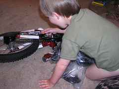 Torrey putting together the bike (whitingjon) Tags: bike torrey