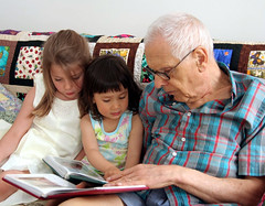 Papa reading to girls