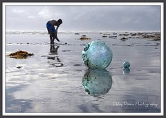 Neptune's Beads (Deby Dixon) Tags: blue green beach silhouette photography washington nikon treasure explorer photojournalism pacificocean pacificbeach deby refection traveler adventurer ddi nikond200 naturephotographer buoyant travelphotographer superaplus aplusphoto travelwriter debydixon glassfishingballs childplayinginocean tourismphotography cted08lic followingthebirds debydixonphotography debydixonimages crustymiddleagedwoman studyingtherelationshipofallelements outdoorchick northwestlover coeurdaleneidahophotographer crazyidahochick ddimages